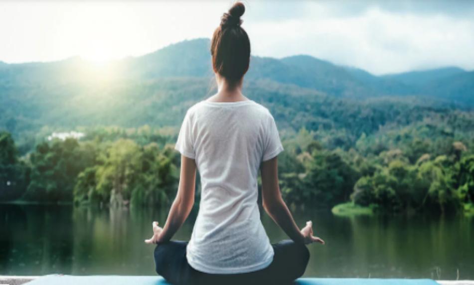 doing yoga over a lake